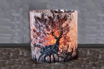 Lysglass frostet med dyr og natur